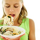 portrait of a young girl eating noodles