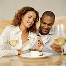 young couple sharing a dessert