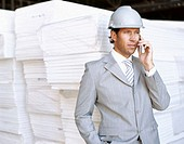 architect talking on a mobile phone at a construction site