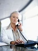 businesswoman using a telephone