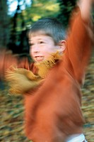 Little boy in the autumnal wood, forest, jumping (thumbnail)