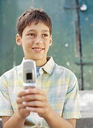 close-up of a boy holding a mobile phone
