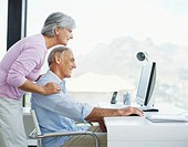 side profile of a mature couple using a computer