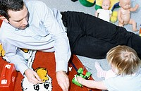 A young father, man, 25-30 30-35 35-40 years old, playing with his little daughter, 1-5 years old (thumbnail)