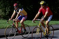 Two young men 15-20 20-25 25-30 years old, sportsmen, bikers, cyclists, cycling outside in summer (thumbnail)