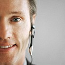 Close-up of a young businessman wearing a telephone headset
