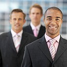 Portrait of three young businessmen standing outdoors