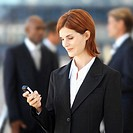 Young businesswoman looking at a mobile phone