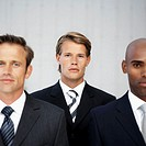 Close-up of three young businessmen