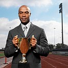 businessman holding trophy portrait