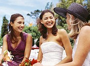 bride sitting with her mother and a bridesmaid