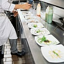 low section view of a chef preparing food in the kitchen