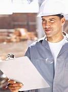 close-up of a male architect holding a clipboard and a pen