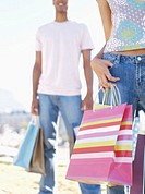 low angle view of young couple holding shopping bags