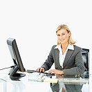 portrait of business woman sitting at a desk