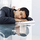 portrait of a young businessman sleeping at work