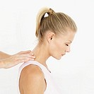 side profile of a woman getting a shoulder massage