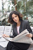 Portrait of a businesswoman holding a newspaper