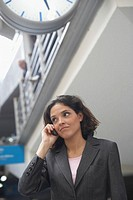 Low angle view of a businesswoman using a mobile phone