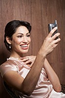 Woman looking at PDA phone