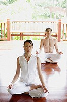 Two people in yoga position