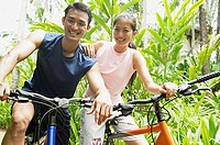 Couple on bicycles, smiling