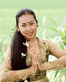 Indonesia, Bali, Balinese dancer in traditional costume, portrait in field