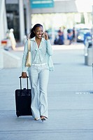 businesswoman walking with luggage