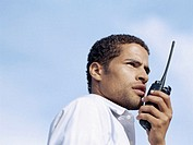 low angle view of a businessman talking on a walkie-talkie