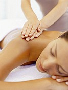 young woman getting a back massage from a massage therapist