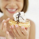 close-up of a girl holding an ice-cream