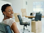 Portrait of businesswoman in office smiling.