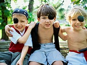 Portrait of three boys pretending to be pirates