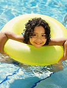 Portrait of a boy in an inflatable ring, smiling
