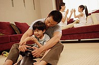 Family in living room, bonding