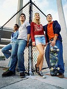 Low angle view of four teenagers standing together