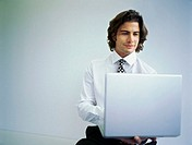 Young businessman working on a laptop
