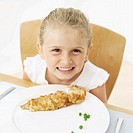Portrait of a young girl (13-14) at the dinner table