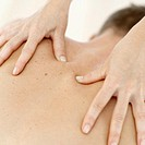 Close-up of a young man getting a back massage from A Woman