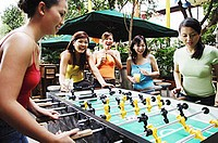 Young women playing foosball