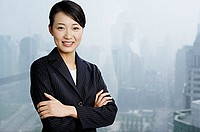Businesswoman looking at camera, arms crossed