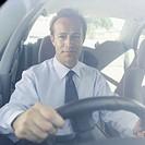 Portrait of a businessman driving a car