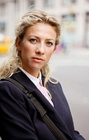 Caucassian businesswoman looking into camera
