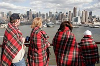 Observation Deck, passengers, skyline, blanket. Holland America Line, MS Noordam. Manhattan. New York. USA