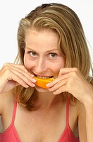 Woman eating a orange