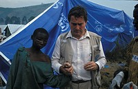HUMANITARIAN MEDICINE<BR>Photo essay for press only.<BR>Father François Lefort in Goma, Rwanda. 1994. Refugee camp, orphans. Zaire.