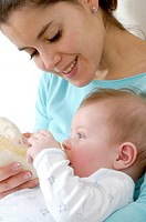 INFANT DRINKING FROM BABY BOTTLE<BR>Models.