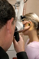 EAR NOSE & THROAT, WOMAN<BR>Models and doctor.<BR>Otorhinolaryngologist. ENT consultation. Examination of the ears.