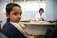 CHILD AT HOSPITAL CONSULTATION<BR>Photo essay at the Regional University Hospital of Lille, France.