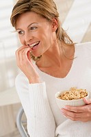 WOMAN EATING BREAKFAST<BR>Model.